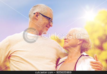senior couple hugging in city park stock photo, family, age, tourism, travel and people concept - senior couple hugging in city park by Syda Productions