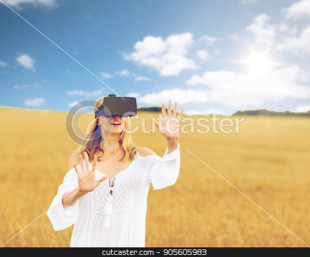woman in virtual reality headset on cereal field stock photo, augmented reality, gaming, summer holidays, technology and people concept - happy young woman with virtual reality headset or 3d glasses on cereal field touching something by Syda Productions