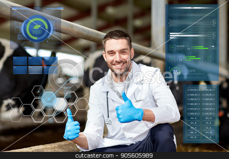 veterinarian and cows in cowshed on dairy farm stock photo, agriculture industry, people and animal husbandry concept - veterinarian or doctor and cows in cowshed on dairy farm showing thumbs up hand sign by Syda Productions