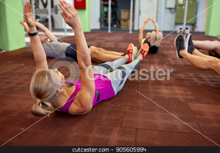 group of people exercising in gym stock photo, fitness, sport, training and lifestyle concept - group of people exercising in gym by Syda Productions