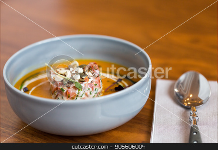 vegetable pumpkin-ginger soup in bowl stock photo, food, new nordic cuisine, culinary and cooking concept - vegetable pumpkin-ginger soup with goat cheese and tomato salad with yogurt in bowl by Syda Productions