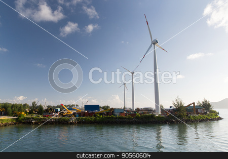 turbines at wind farm on sea shore stock photo, renewable energy, technology and power concept - turbines at wind farm on sea shore by Syda Productions