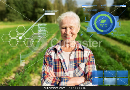 happy senior woman at farm stock photo, organic farming, agriculture and people concept - happy senior woman at farm by Syda Productions