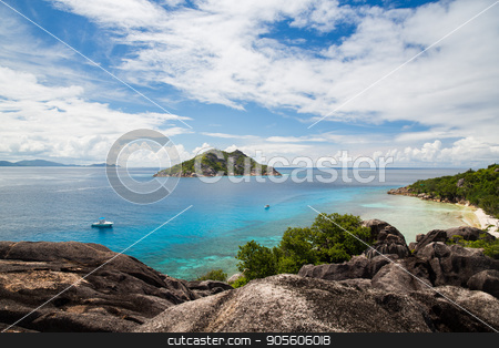 island and boats in indian ocean on seychelles stock photo, travel, landscape and nature concept - island and boats in indian ocean on seychelles by Syda Productions