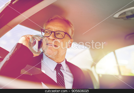 senior businessman calling on smartphone in car stock photo, transport, business trip, technology and people concept - senior businessman calling on smartphone and driving on car back seat by Syda Productions