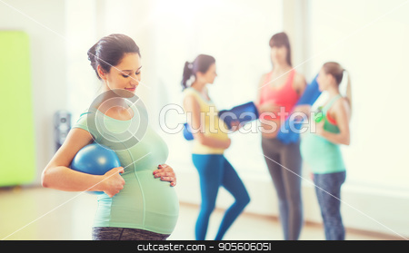 happy pregnant woman with ball in gym stock photo, pregnancy, sport, fitness, people and healthy lifestyle concept - happy pregnant woman with ball in gym by Syda Productions