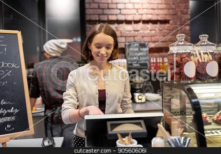 happy woman or barmaid with cashbox at cafe stock photo, small business, people and service concept - happy woman or barmaid at counter with cashbox working in cafe or coffee shop by Syda Productions