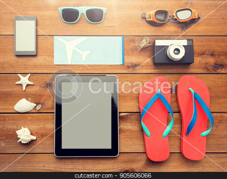 close up of tablet pc and travel stuff stock photo, vacation, travel, tourism, technology and objects concept - close up of tablet pc computer and travel stuff by Syda Productions