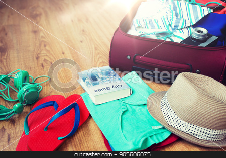 close up of travel bag with clothes and stuff stock photo, summer vacation, travel, tourism and objects concept - close up of travel bag with clothes and stuff by Syda Productions