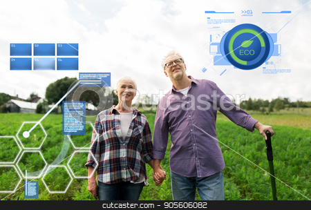 happy senior couple at summer farm stock photo, organic farming, agriculture and people concept - happy senior couple at summer farm by Syda Productions