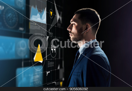 businessman in suit looking at virtual projection stock photo, business, people and technology concept - businessman in suit looking at virtual projection over black background by Syda Productions