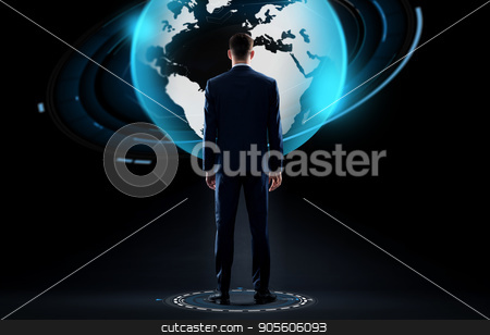 businessman with earth globe hologram over black stock photo, business, people and technology concept - businessman in suit with earth globe hologram over black background by Syda Productions