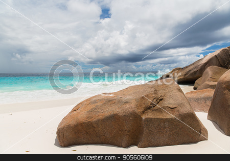island beach in indian ocean on seychelles stock photo, travel, seascape and nature concept - rocks on island beach in indian ocean on seychelles by Syda Productions