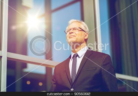 senior businessman on city street stock photo, business and people concept - senior businessman on city street by Syda Productions