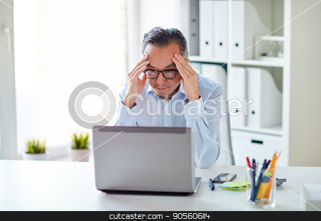 businessman in eyeglasses with laptop at office stock photo, business, deadline, stress, people and technology concept - businessman in eyeglasses with laptop computer at office by Syda Productions