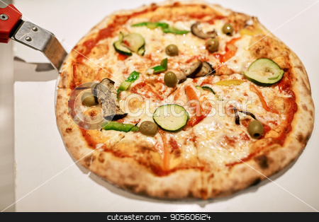 close up of pizza on peel at pizzeria stock photo, fast food, italian cuisine, cooking and eating concept - close up of pizza on peel at pizzeria by Syda Productions
