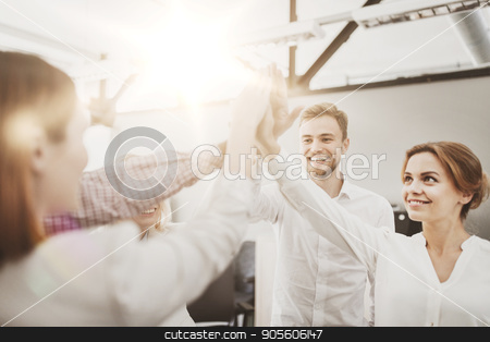 happy business team making high five at office stock photo, business, startup, gesture, people and teamwork concept - happy creative team making high five at office by Syda Productions