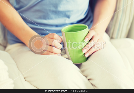 close up of young woman with tea cup stock photo, people and drinks concept - close up of young woman with tea cup by Syda Productions