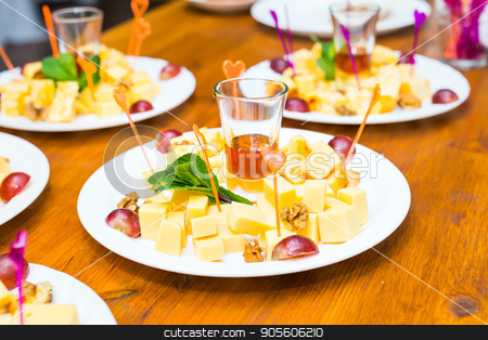 Cubes of yellow cheese stock photo, Cubes of yellow cheese on the plate by Satura86