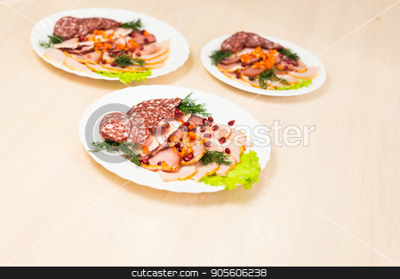 Dish with sliced meat products on the festive table stock photo, Dish with sliced meat products on the festive table by Satura86