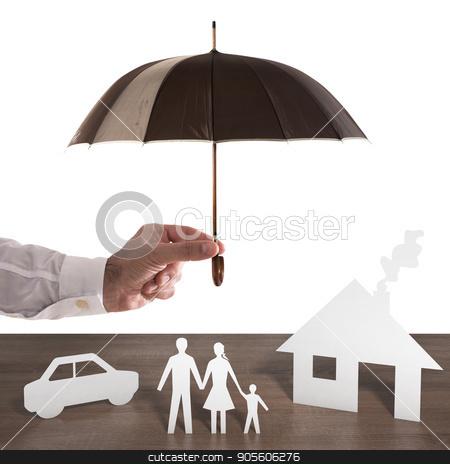 Protect  your famil stock photo, Paper family covered by an umbrella. Protect your family concept by Federico Caputo