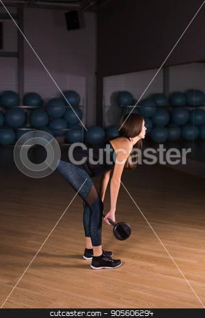Beautiful fitness woman. Sporty woman lifting light weights. Fit girl exercising building muscles. Fitness and bodybuilding stock photo, Beautiful fitness woman with lifting dumbbells . Sporty woman lifting light weights. Fit girl exercising building muscles. Fitness and bodybuilding by Satura86