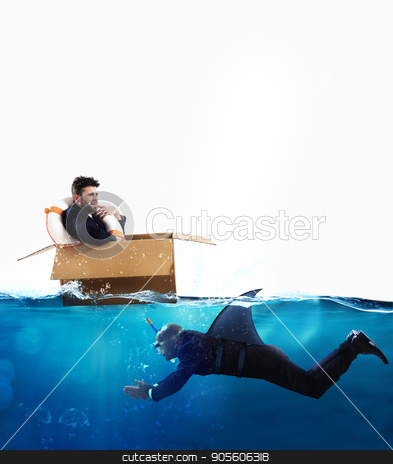 Fear of crisis and business competition concept stock photo, Fearful Businessman on cardboard while businessman with fin shark swims under water by Federico Caputo