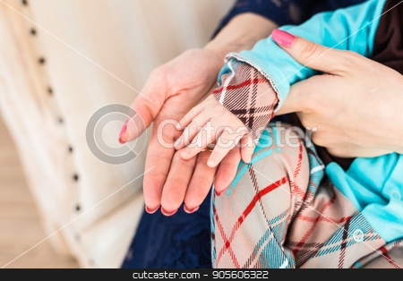 Concept of love and family. hands of mother and baby closeup stock photo, Concept of love and family. hands of mother and baby closeup by Satura86