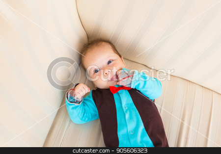 bright portrait of adorable baby top view stock photo, bright portrait of adorable baby boy indoors by Satura86