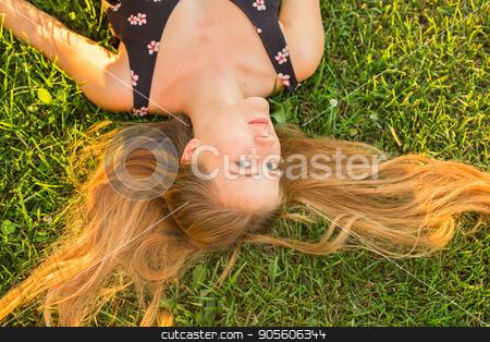 Beautiful Young Woman lying in Meadow. Enjoy Nature stock photo, Beautiful Young Woman lying in Meadow. Enjoy Nature by Satura86