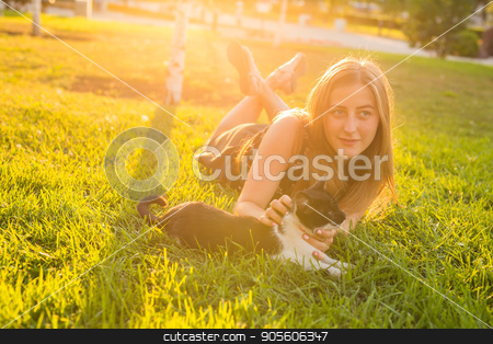Cute Cat and Woman playing with him Outdoor Lifestyle, Friendship and Pet Owner concept stock photo, Cute Cat and Woman playing with him Outdoor Lifestyle, Friendship and Pet Owner concept by Satura86
