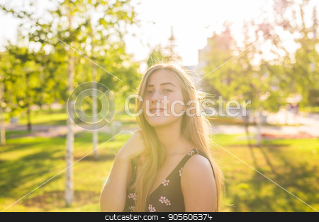 Summer girl portrait. Happy woman smiling on sunny summer or spring day outside in park. Pretty Caucasian woman outdoors stock photo, Summer girl portrait. Happy woman smiling on sunny summer or spring day outside in park. Pretty Caucasian woman outdoors by Satura86