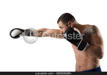 Confident boxer with fiery boxing gloves stock photo, Determined and confident boxer with fiery boxing gloves by Federico Caputo