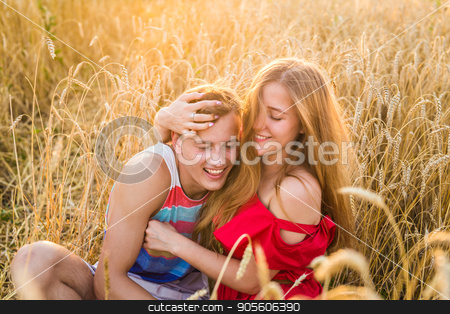 young couple having fun and playing on the field stock photo, young couple having fun and playing on the field by Satura86