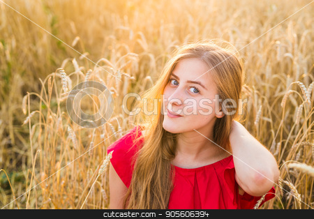 Beautiful young lady in wheat field at sunset stock photo, Beautiful young lady in wheat field at sunset by Satura86