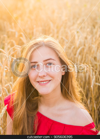 Portrait of a young woman in red dress on a background of golden oats field, summer outdoors stock photo, Portrait of a young woman in red dress on a background of golden oats field, summer outdoors by Satura86