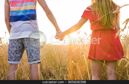 Happy young couple walking on wheat field stock photo, Happy young couple walking on wheat field by Satura86