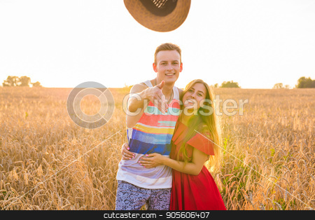 romantic couple having fun in the field stock photo, romantic couple having fun in the field, man and woman by Satura86