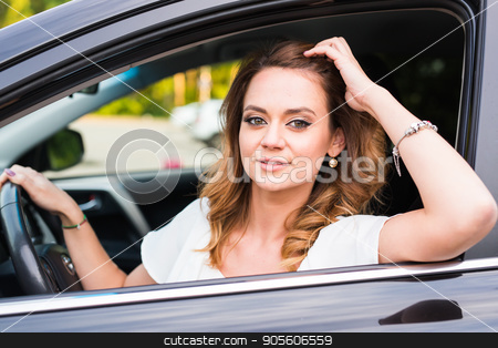 Portrait of smiling young woman driving a car stock photo, Portrait of smiling young african american woman driving a car by Satura86