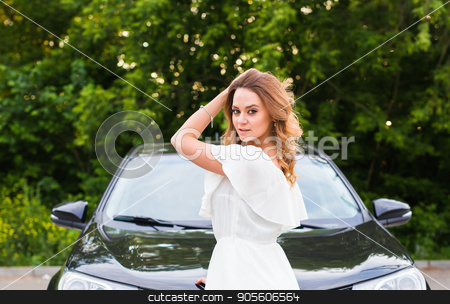 A young woman in a white dress with a black car outdoor stock photo, A young woman in a white dress with a black car outdoor by Satura86