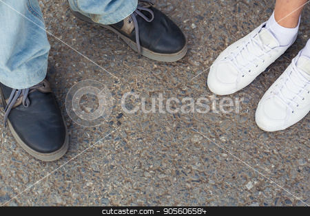 Close-up of male and female legs in fashion shoes top view stock photo, Close-up of male and female legs in fashion shoes top view by Satura86