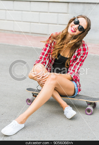 Beautiful young woman in sunglasses seat on skate, street fashion lifestyle stock photo, Beautiful young woman in sunglasses seat on skate, street fashion lifestyle by Satura86