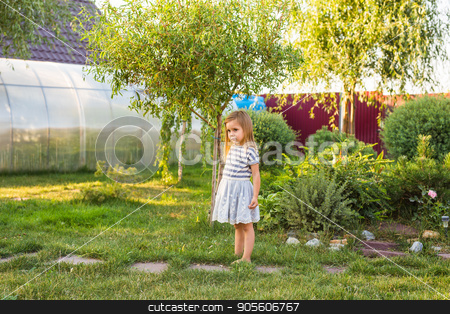 happy child girl playing in summer in nature stock photo, happy child girl playing on meadow in summer in nature by Satura86