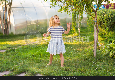 cute little girl in spring or summer day stock photo, Cute little girl on the meadow in spring or summer day by Satura86
