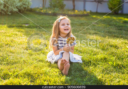 cute cauasian baby girl and big lollipop stock photo, cute cauasian baby girl and big lollipop by Satura86