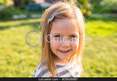 Portrait cute little girl in spring or summer day stock photo, Cute little girl on the meadow in spring or summer day by Satura86