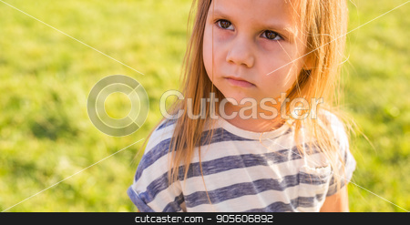 Portrait of cute little girl is playing in summer park stock photo, Cute little girl is playing in summer park by Satura86