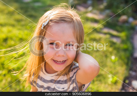 Portrait of happy child girl playing in summer in nature stock photo, happy child girl playing on meadow in summer in nature by Satura86