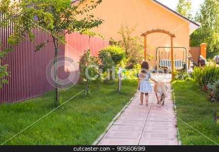 Cute little child girl with dog stock photo, Cute little child girl with dog playing in summer garden by Satura86