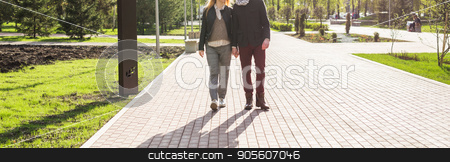 Stylish couple in love holding hands on the street, woman is pregnant stock photo, Stylish couple in love holding hands on the street, woman is pregnant by Satura86